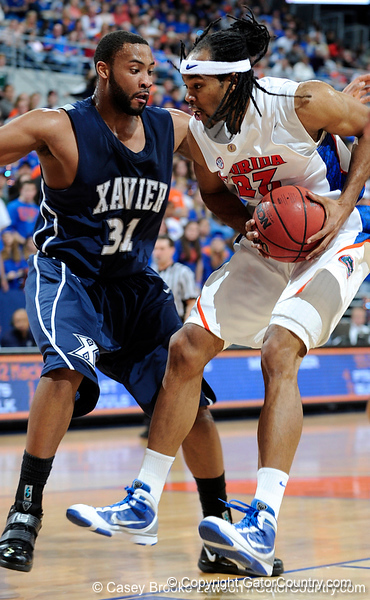 University of Florida forward Alex Tyus moves the ball past an Xavier player during the Gators 64-76 loss to the Musketeers in Gainesville, Fla., on Saturday, February 13, 2010. / Gator Country photo by Casey Brooke Lawson