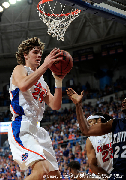 University of Florida forward Chandler Parsons grabs a rebound over an Xavier player during the Gators 64-76 loss to the Musketeers in Gainesville, Fla., on Saturday, February 13, 2010. / Gator Country photo by Casey Brooke Lawson