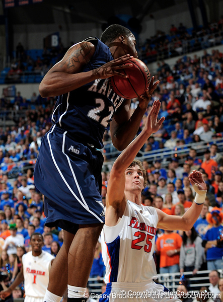 An Xavier player grabs a rebound over University of Florida forward Chandler Parsons during the Gators 64-76 loss to the Musketeers in Gainesville, Fla., on Saturday, February 13, 2010. / Gator Country photo by Casey Brooke Lawson