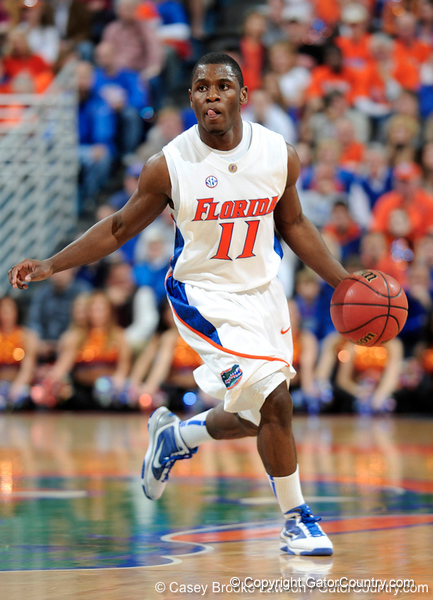 University of Florida guard Erving Walker moves the ball past an Xavier player during the Gators 64-76 loss to the Musketeers in Gainesville, Fla., on Saturday, February 13, 2010. / Gator Country photo by Casey Brooke Lawson
