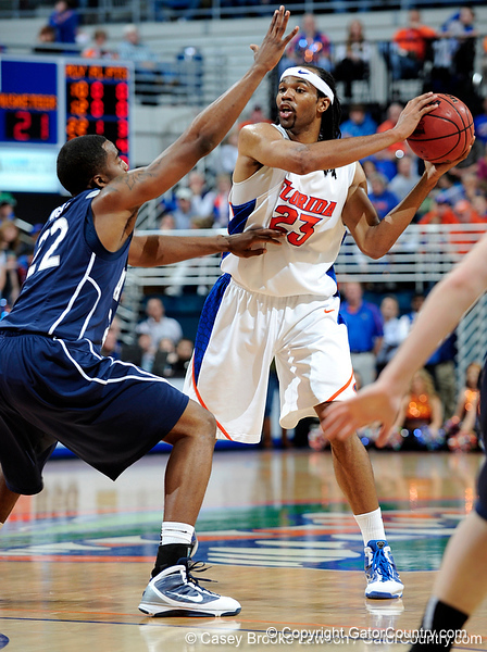 University of Florida forward Alex Tyus attempts to move the ball past an Xavier player during the Gators 64-76 loss to the Musketeers in Gainesville, Fla., on Saturday, February 13, 2010. / Gator Country photo by Casey Brooke Lawson