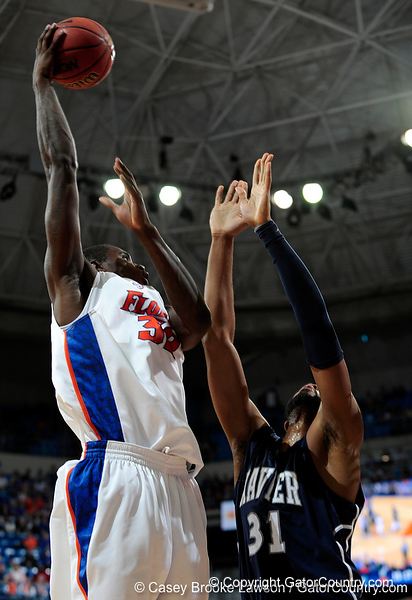 University of Florida forward Erik Murphy moves the ball past an Xavier player during the Gators 64-76 loss to the Musketeers in Gainesville, Fla., on Saturday, February 13, 2010. / Gator Country photo by Casey Brooke Lawson