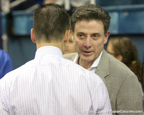 Florida head coach Billy Donovan talks with Rick Pitino after the Gators' 69-49 win against Georgia Southern on Wednesday, November 18, 2009 at the Stephen C. O'Connell Center in Gainesville, Fla. / photo by Tim Casey