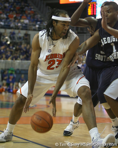 Florida junior forward Alex Tyus gathers the ball during the Gators' 69-49 win against Georgia Southern on Wednesday, November 18, 2009 at the Stephen C. O'Connell Center in Gainesville, Fla. / photo by Tim Casey