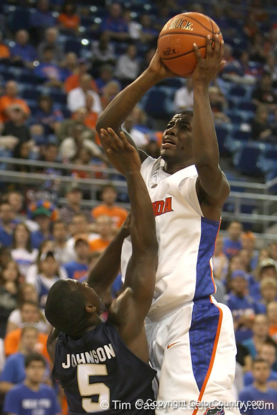 Florida freshman guard Kenny Boynton gets fouled by Georgia Southern's Antoine Johnson during the first half of the Gators' 69-49 win against the Eages on Wednesday, November 18, 2009 at the Stephen C. O'Connell Center in Gainesville, Fla. / photo by Tim Casey
