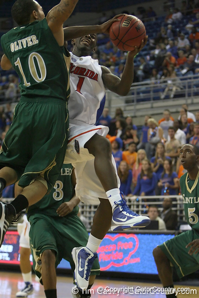 Florida freshman guard Kenny Boynton gets fouled while shooting during the Gators' 95-46 exhibition game win against the St. Leo Lions on Monday, November 2, 2009 at the Stephen C. O'Connell Center in Gainesville, Fla. / Gator Country photo by Tim Casey