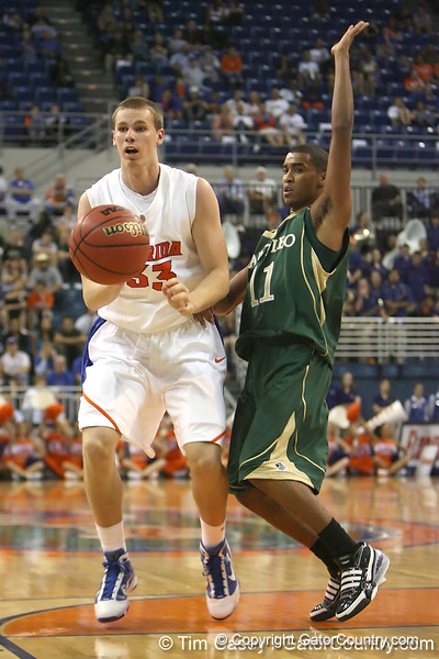 Florida freshman forward Erik Murphy passes the ball during the Gators' 95-46 exhibition game win against the St. Leo Lions on Monday, November 2, 2009 at the Stephen C. O'Connell Center in Gainesville, Fla. / Gator Country photo by Tim Casey