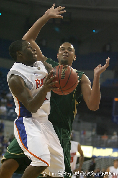 Florida sophomore guard Erving Walker shoots a layup during the Gators' 95-46 exhibition game win against the St. Leo Lions on Monday, November 2, 2009 at the Stephen C. O'Connell Center in Gainesville, Fla. / Gator Country photo by Tim Casey