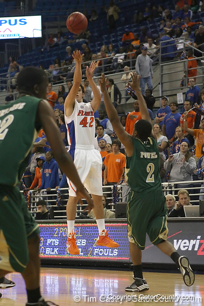 Florida freshman guard Rod Tishman shoots for three during the Gators' 95-46 exhibition game win against the St. Leo Lions on Monday, November 2, 2009 at the Stephen C. O'Connell Center in Gainesville, Fla. / Gator Country photo by Tim Casey