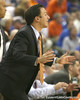 Florida assistant coach Richard Pitino calls in a play during the Gators' 95-46 exhibition game win against the St. Leo Lions on Monday, November 2, 2009 at the Stephen C. O'Connell Center in Gainesville, Fla. / Gator Country photo by Tim Casey