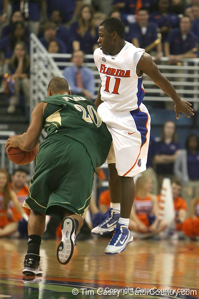 Florida sophomore guard Erving Walker goes for a steal during the Gators' 95-46 exhibition game win against the St. Leo Lions on Monday, November 2, 2009 at the Stephen C. O'Connell Center in Gainesville, Fla. / Gator Country photo by Tim Casey