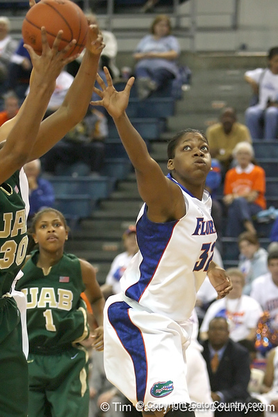 Florida freshman forward Jennifer George reaches for a rebound during the Gators' 75-39 win against the UAB Blazers on Tuesday, November 24, 2009 at the Stephen C. O'Connell Center in Gainesville, Fla. / photo by Tim Casey