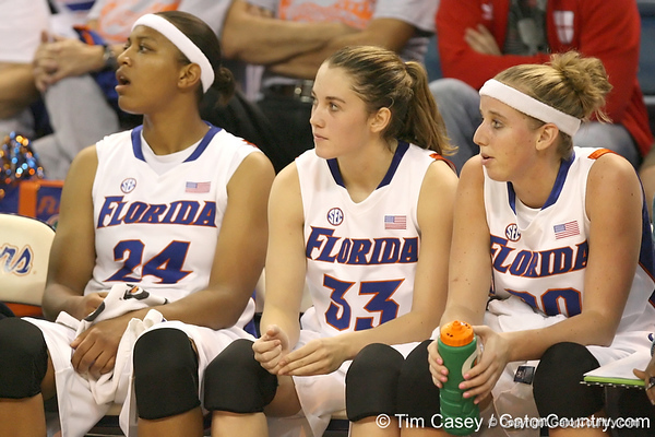 Florida senior forward Sharielle Smith, redshirt-sophomore Jordan Jones and redshirt-senior guard Susan Yenser watch from the bench during the Gators' 75-39 win against the UAB Blazers on Tuesday, November 24, 2009 at the Stephen C. O'Connell Center in Gainesville, Fla. / photo by Tim Casey