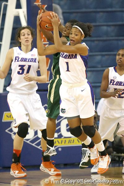 Florida freshman guard Christal Calwell grabs a rebound during the Gators' 75-39 win against the UAB Blazers on Tuesday, November 24, 2009 at the Stephen C. O'Connell Center in Gainesville, Fla. / photo by Tim Casey