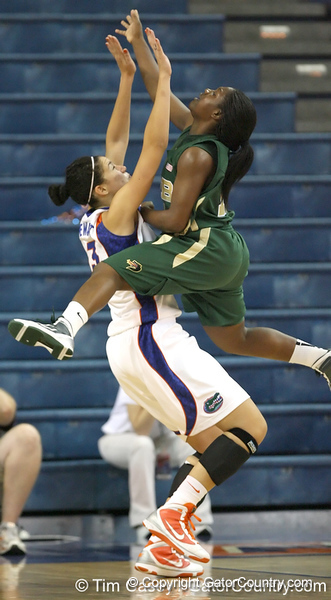 Florida sophomore center Azania Stewart takes a charge during the Gators' 75-39 win against the UAB Blazers on Tuesday, November 24, 2009 at the Stephen C. O'Connell Center in Gainesville, Fla. / photo by Tim Casey