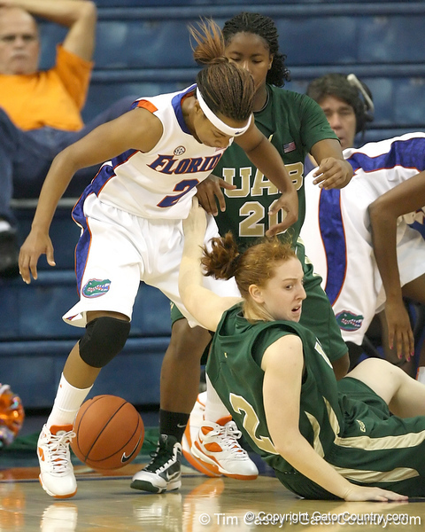 Florida senior guard Lonnika Thompson reaches for a loose ball during the Gators' 75-39 win against the UAB Blazers on Tuesday, November 24, 2009 at the Stephen C. O'Connell Center in Gainesville, Fla. / photo by Tim Casey
