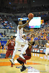 Florida forward Casey Prather drives past the South Carolina defender and lays in the basket.  Florida Gators vs South Carolina Gamecocks.  Gainesville, FL.  January 8, 2013.  Gator Country photo by David Bowie.