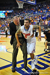 Florida guard Scottie Wilbekin is helped up and off the floor by Florida athletic trainer Dave Werner after coming down weird on his ankle.  Florida Gators vs South Carolina Gamecocks.  Gainesville, FL.  January 8, 2013.  Gator Country photo by David Bowie.
