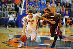Florida guard Scottie Wilbekin drives past South Carolina guard Sindarius Thornwell on his way to the net.  Florida Gators vs South Carolina Gamecocks.  Gainesville, FL.  January 8, 2013.  Gator Country photo by David Bowie.