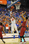 Florida forward Will Yeguete drives the lane and puts in the shot early in the first half.  Florida Gators vs South Carolina Gamecocks.  Gainesville, FL.  January 8, 2013.  Gator Country photo by David Bowie.