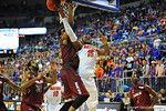 Florida forward Will Yeguete is fouled on the reverse layup.  Florida Gators vs South Carolina Gamecocks.  Gainesville, FL.  January 8, 2013.  Gator Country photo by David Bowie.