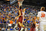 Florida guard Scottie Wilbekin drives to the net and is fouled.  Florida Gators vs South Carolina Gamecocks.  Gainesville, FL.  January 8, 2013.  Gator Country photo by David Bowie.