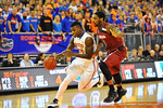 Florida forward Casey Prather drives to the net past South Carolina guard Sindarius Thornwell.  Florida Gators vs South Carolina Gamecocks.  Gainesville, FL.  January 8, 2013.  Gator Country photo by David Bowie.
