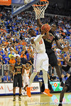 Florida forward Will Yeguete tries to put in the reverse layup in the fist half.  Florida Gators vs Florida State Seminoles.  Gainesville, FL.  November 29, 2013.