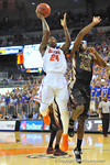 Florida foward Casey Prather drives the lane and puts up the shot in the second half.  Florida Gators vs Florida State Seminoles.  Gainesville, FL.  November 29, 2013.