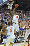 Florida forward Dorian Finney-Smith (10) puts up the shot in the first half.  Florida Gators vs Florida State Seminoles.  Gainesville, FL.  November 29, 2013.