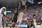 Florida foward Will Yeguete drives the lay and puts in the layup in the second half.  Florida Gators vs Florida State Seminoles.  Gainesville, FL.  November 29, 2013.