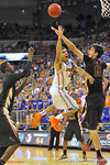 Florida guard Scottie Wilbekin puts up the shot as he is fouled in the second half.  Florida Gators vs Florida State Seminoles.  Gainesville, FL.  November 29, 2013.