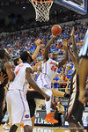 Florida guard Casey Prather (24) drives the lane and puts up the shot as he is fouled in the second half.  Florida Gators vs Florida State Seminoles.  Gainesville, FL.  November 29, 2013.