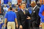 Florida Gator head coach Billy Donovon and Florida State Seminoles head coach Leonard Hamilton greet before the game.  Florida Gators vs Florida State Seminoles.  Gainesville, FL.  November 29, 2013.