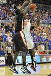 Florida forward Dorian Finney-Smith (10) puts up the shot in the first half.  Florida Gators vs Florida State Seminoles.  Gainesville, FL.  November 29, 2013.