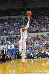 Florida forward Will Yeguete puts up the jump shot in the second half.  Florida Gators vs Florida State Seminoles.  Gainesville, FL.  November 29, 2013.