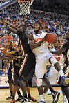 Florida Gator center Patric Young comes down with the offensvie rebound in the first half.  Florida Gators vs Florida State Seminoles.  Gainesville, FL.  November 29, 2013.