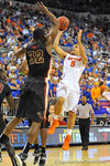 Florida Gator guard Scottie Wilbekin (5) drives the lane and puts up the shot in the fist half.  Florida Gators vs Florida State Seminoles.  Gainesville, FL.  November 29, 2013.