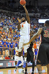 Florida Gator center Patric Young turns and puts up a hook.  Florida Gators vs Florida State Seminoles.  Gainesville, FL.  November 29, 2013.