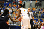 Florida guard Eli Carter dribbles up court shouting out the play in the first half vs North Florida.  Florida Gators vs North Florida Ospreys.  November 8th, 2013.
