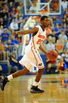 Florida guard Michael Frazier dribbles up court calling out the play in the second half vs North Florida.  Florida Gators vs North Florida Ospreys.  November 8th, 2013.