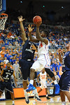 Florida foward Casey Prather scores the layup over the outstretched arm of North Florida's Travis Wallace.  Florida Gators vs North Florida Ospreys.  November 8th, 2013.