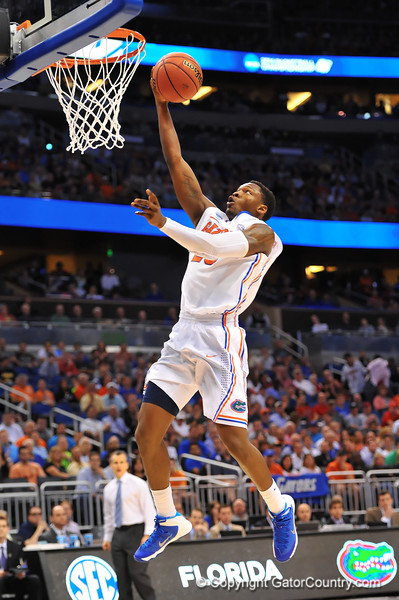 Florida guard Michael Frazier with a lay on a breakaway late in the second half.  Florida Gators vs Pitt Panthers.  March 22nd, 2014.  Gator Country photo by David Bowie.