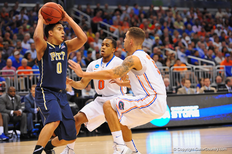 Pitt guard James Robinson is pressured by Gators Kasey Hill and Scottie Wilbekin in the second half.  Florida Gators vs Pitt Panthers.  March 22nd, 2014.  Gator Country photo by David Bowie.