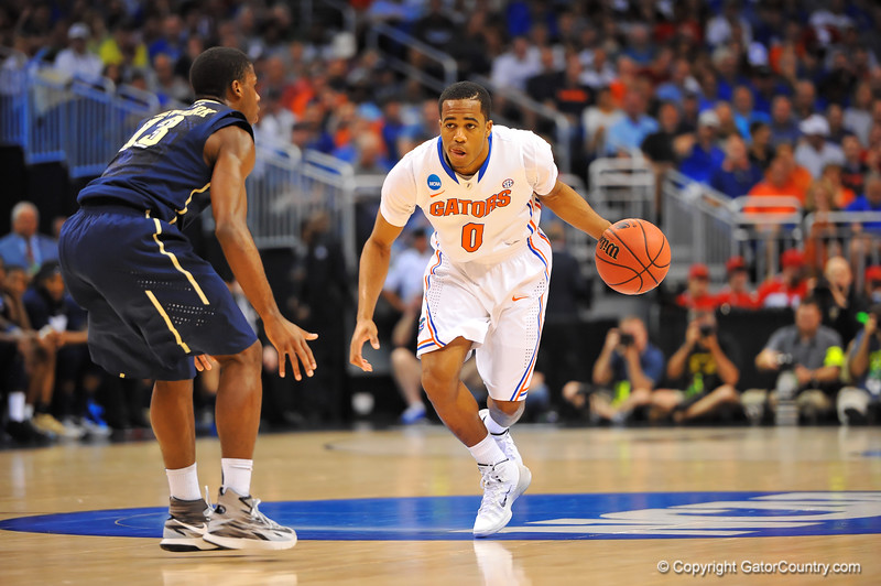 Florida guard Kasey Hill dribbles up court in the second half.  Florida Gators vs Pitt Panthers.  March 22nd, 2014.  Gator Country photo by David Bowie.