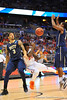 Florida forward Casey Prather is fouled by Pitt forward Derrick Randall.  Florida Gators vs Pitt Panthers.  March 22nd, 2014.  Gator Country photo by David Bowie.