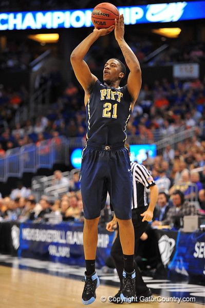 Pitt forward Lamar Patterson drains the three point shot in the first half.  Florida Gators vs Pitt Panthers.  March 22nd, 2014.  Gator Country photo by David Bowie.