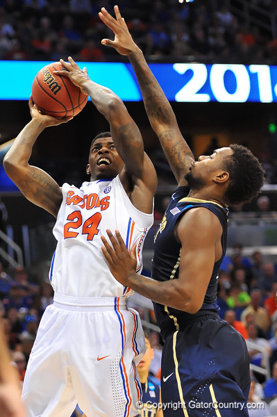 Florida forward Casey Prather leaps up to take the shot in the second half.  Florida Gators vs Pitt Panthers.  March 22nd, 2014.  Gator Country photo by David Bowie.