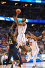 Florida center Patric Young leaps into the air with a turnaround jumper in the second half over Pitt center Talib Zanna.  Florida Gators vs Pitt Panthers.  March 22nd, 2014.  Gator Country photo by David Bowie.