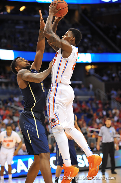 Florida forward Casey Prather leaps up for the jump shot over Pitt forward Michael Young.  Florida Gators vs Pitt Panthers.  March 22nd, 2014.  Gator Country photo by David Bowie.